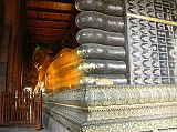 Also known as the Temple of the Reclining Buddha, Wat Po was built by Rama I in the 16C and is the oldest and largest Buddhist temple in Bangkok. The enormous Reclining Buddha is 46m long and 15m high, with each foot 3m high and 5m long. The statue is brick, covered with layers of plaster, and gold leaf. The most striking part of the statue is its soles, which are decorated with 108 auspicious patterns inlaid with mother-of-pearl.